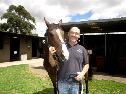 Scott Brodie with one of the horses stabled at Canterbury Racecourse. Photo: Nadyat El Gawley